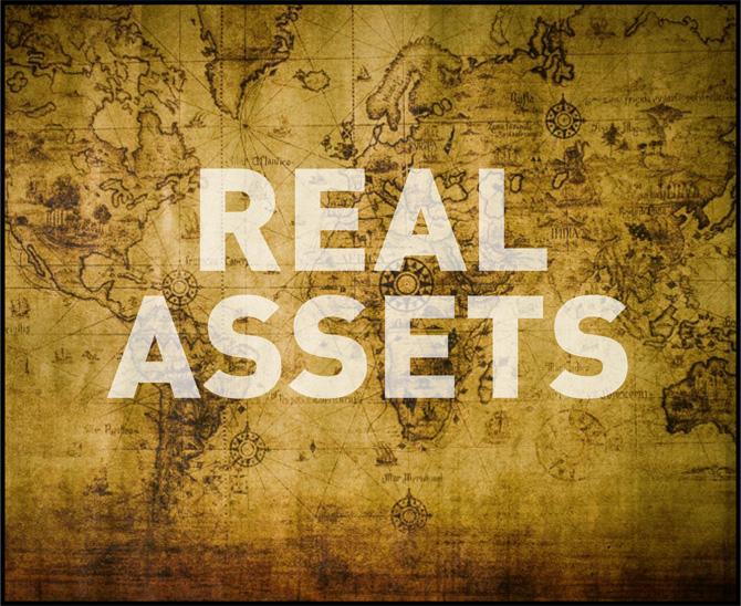 Das Bild einer altertümlichen Landkarte, auf der Real Assets steht.